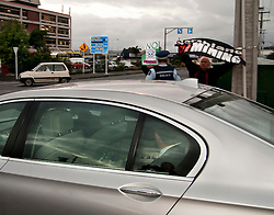 Prime Minister John Key drives past anti mining protesters after visiting the Northland Club in Whangarei with local MP and Minister of Energy and Resources Phil Heatley, Northland, New Zealand, July 26, 2012. Credit:SNPA / Malcolm Pullman