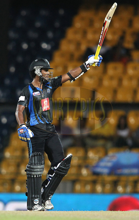 Dinesh Chandimal of Wayamba United raises his bat after reaching his fifty during match 20 of the Sri Lankan Premier League between Ruhuna Royals and Wayamba United held at the Premadasa Stadium in Colombo, Sri Lanka on the 26th August 2012. .Photo by Shaun Roy/SPORTZPICS/SLPL
