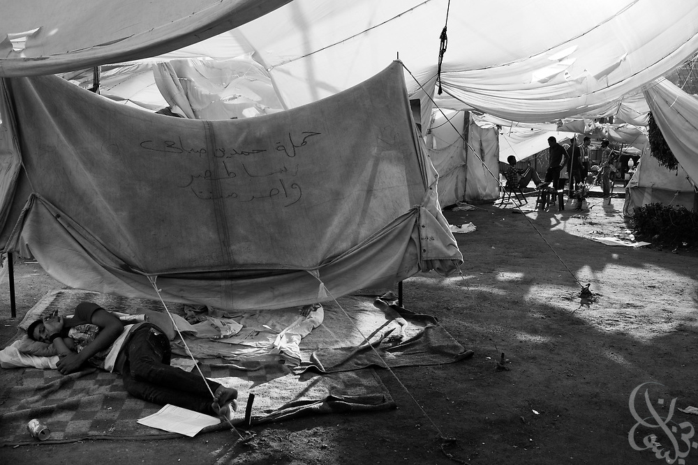 An Egyptian activist sleeps under a tent in Tahrir Square in Cairo, Egypt July 31,2011. Nearly six months after the Jan 25 revolution, many activists, families of martyrs and victims occupying the square are still struggling to obtain justice and to fulfill the goals of the revolution. (Photo by Scott Nelson for Stern)