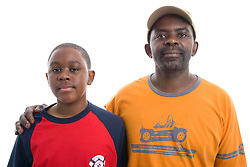 Portrait of a father and teenage son in the studio,