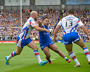 Warrington Wolves Chris Sandow cuts back on Wakefield Trinity Wildcats Liam Finn and Anthony Tupou during the Ladbrokes Challenge Cup Semi-Final  match Warrington Wolves -V- Wakefield Trinity Wildcats at , Leigh, Greater Manchester, England on Saturday, July 30, 2016. (Steve Flynn/Image of Sport)