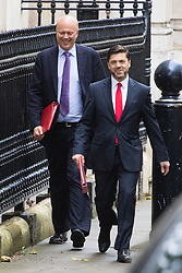 Downing Street,  London, June 27th 2015. Leader of the House of Commons Chris Grayling, left, and Work and Pensions Secretary Stephen Crabb arrive for the first post-Brexit cabinet meeting at 10 Downing Street.