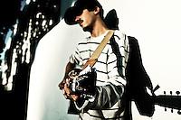 Singer/songwriter Alex Dupont plays outside studio in Berkeley, CA.  Copyright 2009 Reid McNally.