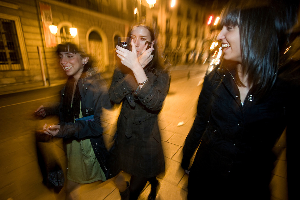 2:03 AM: Marta Selgas, 23, María Padín, 25, and Ángela Hermosa, 23, walk on the street of Madrid, heading to the clubs.