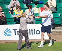 NOTTINGHAM, ENGLAND - Thursday, June 11, 2009: A spectator plays a point for Greg Rusedski (GBR) on centre court on day one of the Tradition Nottingham Masters tennis event at the Nottingham Tennis Centre. (Pic by David Rawcliffe/Propaganda)