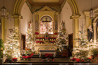 Chisrtmas Eve with trees around the altar at Ysleta Mission in El Paso, Texas.