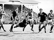 Dave Loveridge dive passes against the British and Irish Lions in 1983. From left: Maurice Colclough, Murray Mexted, Graham Price, Jock Hobbs and Peter Winterbottom. New Zealand All Blacks. Eden Park, Auckland. 17 July 1983. Photo: PHOTOSPORT/Peter Bush