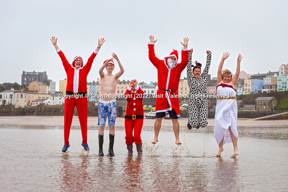 Swimmers in Santa Claus / Father Christmas costumes<br /> Tenby Boxing Day Swim 2011<br /> Tenby<br /> Pembrokeshire<br /> South<br /> Events