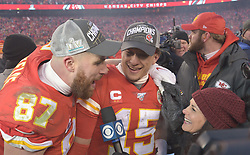 Jan 19, 2020; Kansas City, Missouri, USA; Kansas City Chiefs quarterback Patrick Mahomes (15) celebrates with tight end Travis Kelce (87) after the AFC Championship Game against the Tennessee Titans at Arrowhead Stadium. Mandatory Credit: Denny Medley-USA TODAY Sports