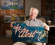 """Bob """"Punchy"""" Powell, WWII fighter pilot who holds a piece of the cowling from his crashed P-51 Mustang."""