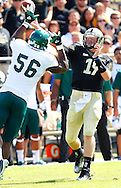 WEST LAFAYETTE, IN - SEPTEMBER 15: Quarterback Caleb TerBush #19 of the Purdue Boilermakers passes the ball as defensive lineman Andy Mulumba #56 of the Eastern Michigan Eagles defends at Ross-Ade Stadium on September 15, 2012 in West Lafayette, Indiana. (Photo by Michael Hickey/Getty Images)***Local Caption***Caleb TerBush; Andy Mulumba