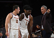 Nov 8, 2019; Los Angeles, CA, USA;  Southern California Trojans head coach Andy Enfield (right) talks with guard Quinton Adlesh (10) and guard Jonah Mathews (2) in the second half against the Portland Pilots at Galen Center USC defeated Portland State 76-65.