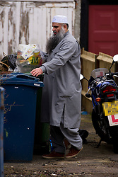 **Registration plate on bike has been pixelated**© London News Pictures. 08/01/2013. London, UK. Radical Preacher Abu Qatada taking out the rubbish at his bail home in London on January 8, 2013. Qatada was recently moved to the new property after Qatada and his family asked to be relocated. Photo Credit: Ben Cawthra/LNP
