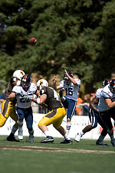 Virginia punter Ryan Weigand (16) punts against Wyoming.  The Wyoming Cowboys defeated the Virginia Cavaliers 23-3 at War Memorial Stadium in Laramie, WY on September 1, 2007.