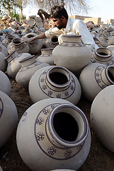A Pakistani man makes pottery at a workshop in southern Pakistani port city of Karachi, Feb. 25, 2015. EXPA Pictures © 2015, PhotoCredit: EXPA/ Photoshot/ Arshad<br /> <br /> *****ATTENTION - for AUT, SLO, CRO, SRB, BIH, MAZ only*****