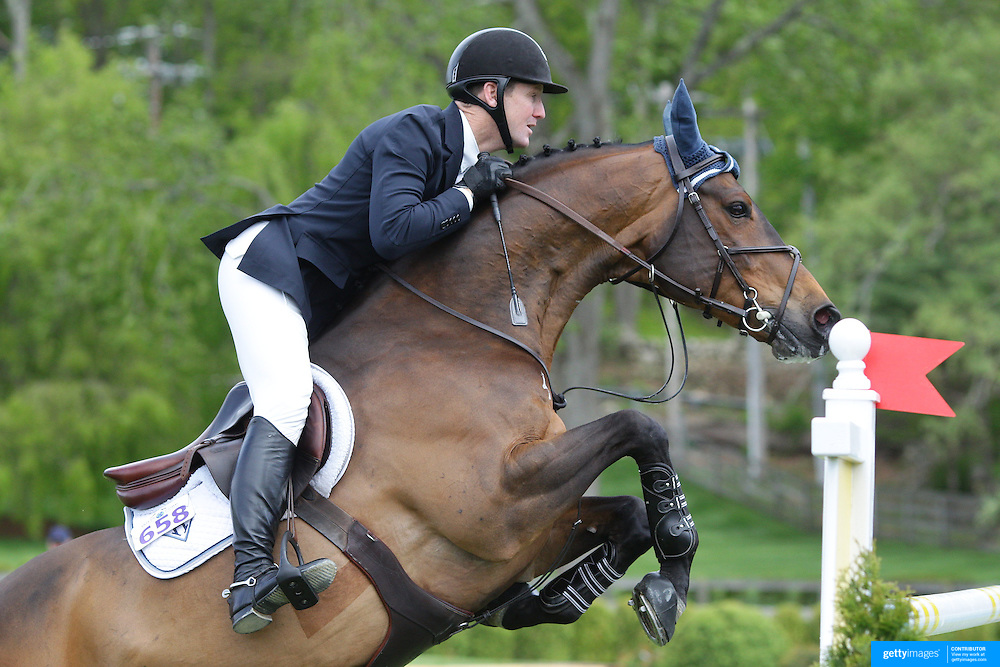 NORTH SALEM, NEW YORK - May 15: McLain Ward, USA, riding HH Carlos Z, in action during The $50,000 Old Salem Farm Grand Prix presented by The Kincade Group at the Old Salem Farm Spring Horse Show on May 15, 2016 in North Salem. (Photo by Tim Clayton/Corbis via Getty Images)