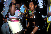Girls dancing in the street, Notting Hill Carnival 2001