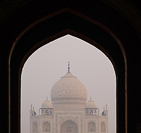 AGRA, INDIA - CIRCA NOVEMBER 2018: Arches and Taj Mahal entrance. The Taj Mahal is an ivory-white marble mausoleum on the south bank of the Yamuna river in the Indian city of Agra. The Taj Mahal is one the most recognizable buildings in India and a World Heritage Site.. Agra is a city and very popular tourist destination on the banks of the Yamuna river in the Indian state of Uttar Pradesh.