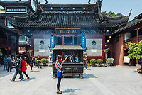 Shanghai, China - April 7, 2013: people praying in the city god temple Chenghuang Miao at the city of Shanghai in China on april 7th, 2013