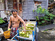 28 OCTOBER 2014 - BANGKOK, THAILAND: A vendor who sells fresh fruit from a push cart loads up his carts at the start of his day in Bangkok.   PHOTO BY JACK KURTZ