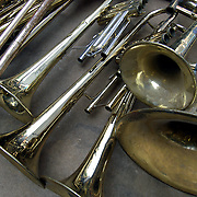 Trumpets abstract patterns on flea market table for sale.<br /> <br /> Trumpet is a musical instrument. It has the highest register in the brass family. As a signaling device in battle or hunting,