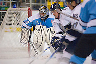 18 February, 2006 - Anchorage, AK:  Matt Underhill watches the puck in the corner of the ice as the IceDogs and Aces battle for position Long Beach IceDogs beat the home team Alaska Aces 4-1 at the Sullivan Arena.