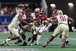 Alabama Crimson Tide quarterback Jalen Hurts (2) carries the ball against the Florida State Seminoles during the Chick-fil-A Kickoff NCAA football game on Saturday, September 2, 2017, in Atlanta. (Paul Abell via Abell Images for Chick-fil-A Kickoff Game)