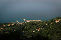 """PISCIOTTA, ITALY - 22 APRIL 2018: A view of the harbor of Pisciotta, Italy, on April 22nd 2018.<br /> <br /> Former restaurant owners Donatella Marino and her husband Vittorio Rimbaldo have spent the recent years preparing and selling salted anchovies, called alici di menaica, to a growing market thanks to a boost in visibility from the non-profit Slow Food.  The ancient Menaica technique is named after the nets they use brought by the Greeks wherever they settled in the Mediterranean. Their process epitomizes the concept of slow food, and involves a nightly excursion with the special, loose nets that are built to catch only the larger swimmers. The fresh, red anchovies are immediately cleaned and brined seaside, then placed in terracotta pots in between layers of salt, to rest for three months before they're aged to perfection.While modern law requires them to use PVC containers for preserving, the government recently granted them permission to use up to 10 chestnut wood barrels for salting in the traditional manner. The barrels are """"washed"""" in the sea for 2-3 days before they're packed with anchovies and sea salt and set aside to cure for 90 days. The alici are then sold in round terracotta containers, evoking the traditional vessels that families once used to preserve their personal supply.<br /> <br /> Unlike conventional nets with holes of about one centimeter, the menaica, with holes of about one and half centimeters, lets smaller anchovies easily swim through. The point may be to concentrate on bigger specimens, but the net also prevents overfishing."""