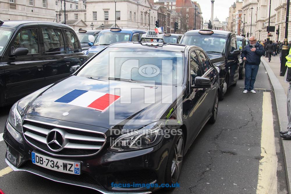 A Paris taxi driver shows solidarity with his London counterparts as an estimated 8,000 cabbies protest against &quot;unfair competition&quot; from Uber mini cabs<br /> Picture by Paul Davey/Focus Images Ltd +447966 016296<br /> 10/02/2016