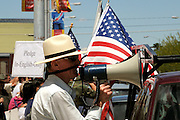 About 6,000 people marched in the La Gran Marcha on May 1, 2010, to Armory Park in Tucson, Arizona, USA. The focus of the march was the protest of the controversial bill SB1070, which addresses illegal immigration.  About 25 supporters of the bill gathered across from Armory Park.