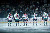 KELOWNA, CANADA - FEBRUARY 8: Tyrell Goulbourne #12, Cody Fowlie #18, Tyson Baillie #24, Jesse Lees #2 and MacKenzie Johnston #22 of the Kelowna Rockets stand on the ice during the national anthem against the Portland Winterhawks at the Kelowna Rockets on February 8, 2013 at Prospera Place in Kelowna, British Columbia, Canada (Photo by Marissa Baecker/Shoot the Breeze) *** Local Caption ***