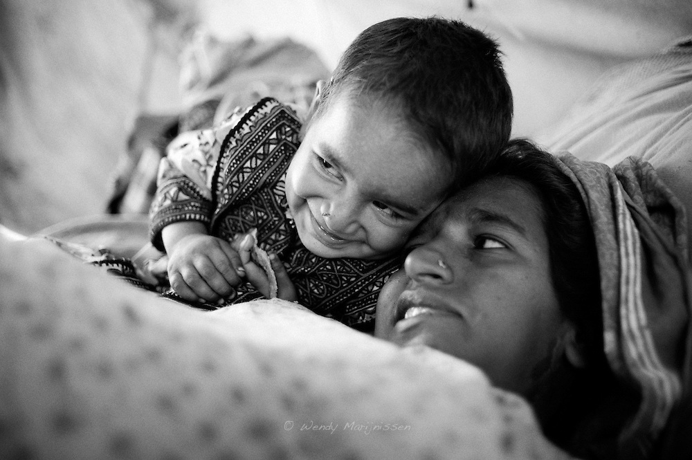Mehmooda makes her mother smile after Hamida was worried and scared she might need a caesarian section to deliver her 4th child. Karachi, Paksitan, 2010