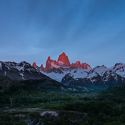 The Fitzroy range turns red and purple for a few minutes at sunrise, Parque Nacional los Glaciers, Argentina.