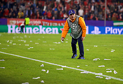 SEVILLE, SPAIN - Tuesday, November 21, 2017: A steward attempts to clean up after Sevilla hooligans threw thousands of missiles onto the pitch during the UEFA Champions League Group E match between Sevilla FC and Liverpool FC at the Estadio Ramón Sánchez Pizjuán. (Pic by David Rawcliffe/Propaganda)