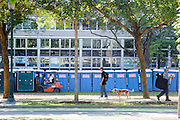Philadelphia, Pennsylvania - September 16, 2015: Pedestrians pass by while a worker forklifts a portable toilet in place, readying the the area surrounding Benjamin Franklin Parkway in Philadelphia for the hoards of people expected to see the Pope.<br /> <br /> Scott Mirkin's company ESM is heading the production of The World Meeting Of Families and Pope Francis's visit to Philadelphia this Fall. The events will take place along the Benjamin Franklin Parkway.<br /> <br /> CREDIT: Matt Roth for The New York Times<br /> Assignment ID: 30179397A