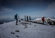 Climbers on the summit of Mt. Asahidake, the northern island of Hokkaido's highest mountain.  Yesterday it experienced Japan's snowfall this year.  This active volcano is part of Japan's largest national park, Daisetsuzan National Park and it in the region known to be the coldest in all Japan.