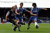 Photo: Paul Thomas.<br /> Oldham Athletic v Swansea City. Coca Cola League 1. 12/08/2006.<br /> <br /> Tom Butler of Swansea (L) has his shot blocked by Gary McDonald and Stefan Stam (R).
