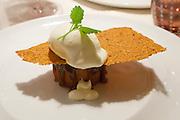 Bad St. Leonhard, Carinthia, Austria. Trippolts Zum Bären gourmet restaurant. The desserts.<br /> Flaumige Orangen-Buttermilch im Nougat-Karamell, Mandel-Krokant und Hollerblüten-Eis.