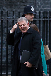 © Licensed to London News Pictures. 09/01/2018. London, UK. Minister without Portfolio and Conservative Party Chair Brandon Lewis points at his head as he arrives on Downing Street for the first meeting of the Cabinet after Prime Minister Theresa May's reshuffle. Photo credit: Rob Pinney/LNP