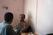 Harare men talk over macchiattos in a cafe in Harar, Ethiopia.
