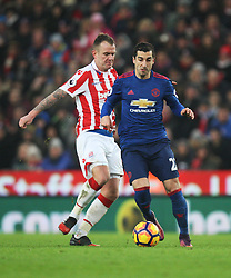 Glenn Whelan of Stoke City (L) and Henrikh Mkhitaryan of Manchester United in action  - Mandatory by-line: Jack Phillips/JMP - 21/01/2017 - FOOTBALL - Bet365 Stadium - Stoke-on-Trent, England - Stoke City v Manchester United - Premier League