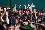 Students from the Scripps College of Communication cheer as their college is announced during the commencement ceremony Saturday May 3, 2014.  Photo by Ohio University / Jonathan Adams3