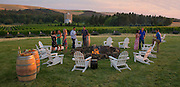 Friends enjoy a special sunset tasting at Figgins Family Vineyard, Walla Walla, Washington
