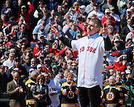 Former Red Sox player Bill Buckner thanks the crowd before throwing the ceremonial first pitch.