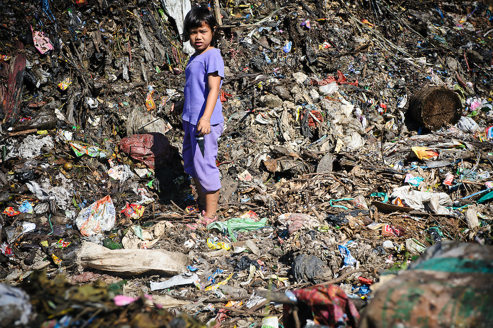Erni, 10, searching for plastic and metal for recycling at the 'Trash mountain', Makassar, Sulawesi, Indonesia.