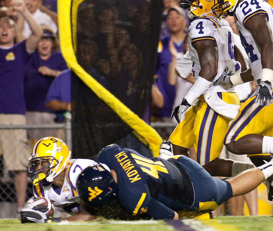LSU Tigers cornerback Patrick Peterson (7) catches an interception from West Virginia Mountaineers.  LSU Tigers leads West Virginia Mountaineers 17-7 at half time.