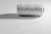 a black and white roll of sewing thread