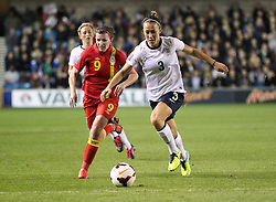 England's Ellen White (Arsenal) battles for the ball with Wales's Helen Lander - IBV Vestmannaeyjar - Photo mandatory by-line: Robin White/JMP - Tel: Mobile: 07966 386802 26/10/2013 - SPORT - FOOTBALL - The Den - Millwall - England Women v Wales Women - World Cup Qualifier - Group 6