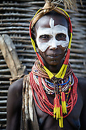Karo tribe,Omo river 2010 The Karo, which number only about 3,000 people, mainly live on the practice of flood retreat cultivationon the banks of the Omo River in southwestern Ethiopia.The Karo excel in face and body painting, practiced in preparation of their dances and ceremonies, they decorate their bodies, often imitating the spotted plumage of a guinea fowl. Feather plumes are inserted in their clay hair buns to complete the look. The clay hair bun can take up to three days to construct and is usually re-made every three to six months. Their painted facemasks are spectacular. Karo women scarify their chests to beautify themselves. Scars are cut with a knife and ash is rubbed to produce a raised welt.<br /> Being the smallest tribe I the area, this group obviously struggles which direct threats from nearby tribes that have more gun power, greater numbers, and likely coalitions with one another.