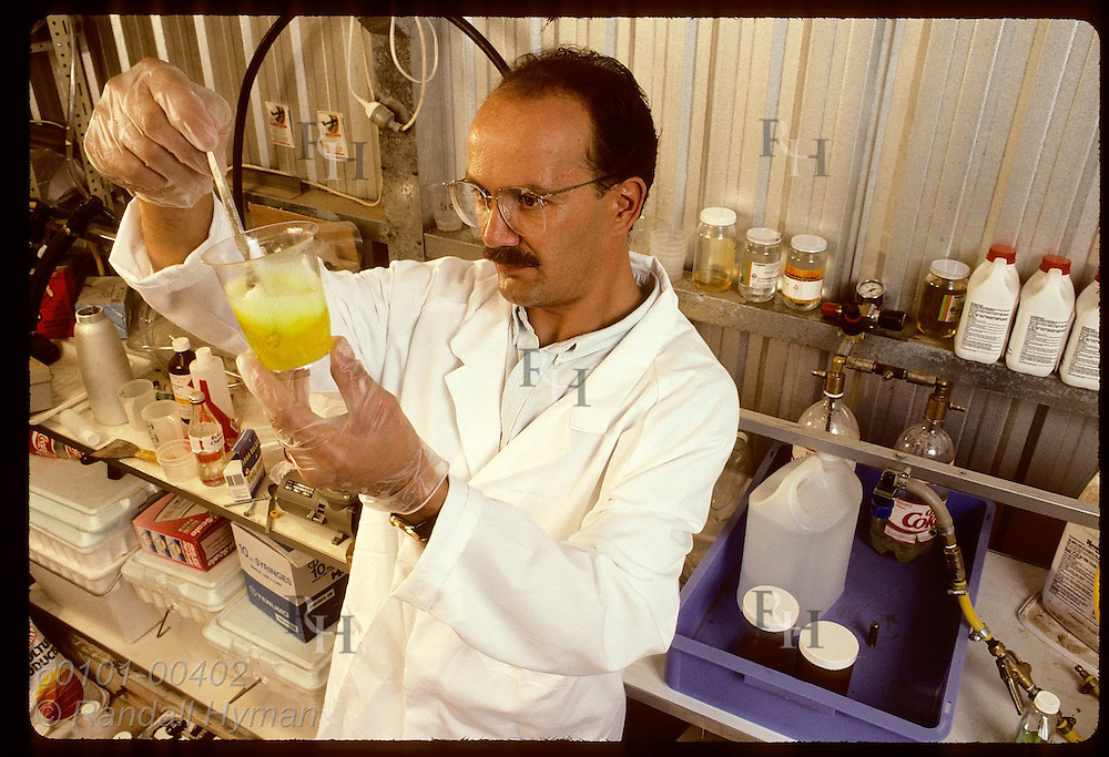 Zel Bodulovic mixes blend of herbicide he developed for Monsanto in his shed; Wagga Wagga, NSW. Australia